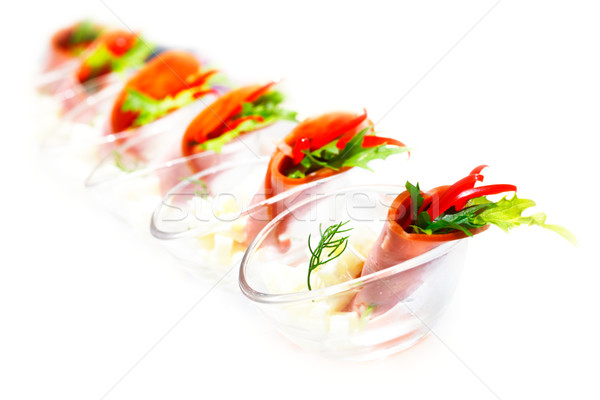Tasty appetizer capsicum and rocket salad wrapped in turkey ham Stock photo © SophieJames