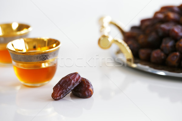 Dried dates and Arabic tea Stock photo © SophieJames