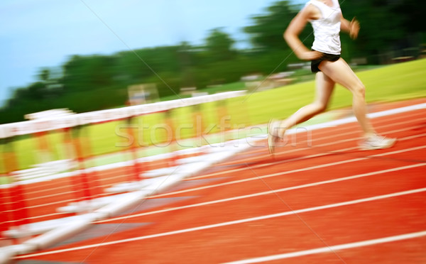 Runner in a hurdle race Stock photo © soupstock