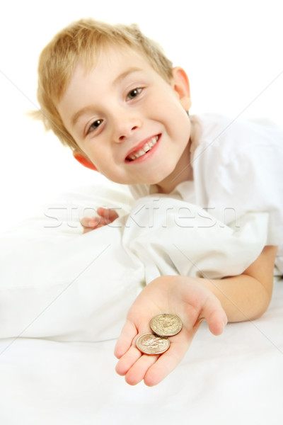 Young boy with a lost tooth, holding money from the tooth fairy Stock photo © soupstock