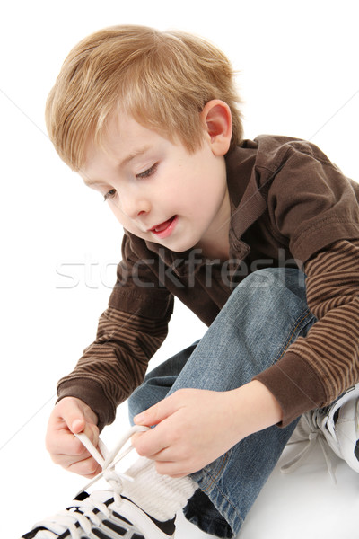 Boy tying his shoes Stock photo © soupstock