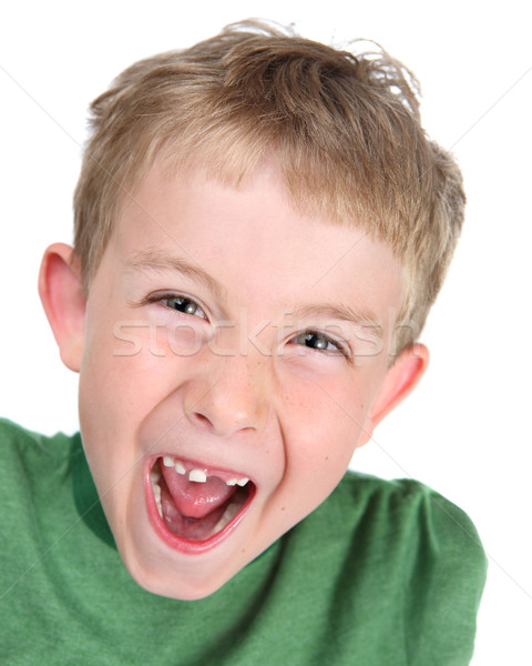 Stock photo: Young boy making a silly face