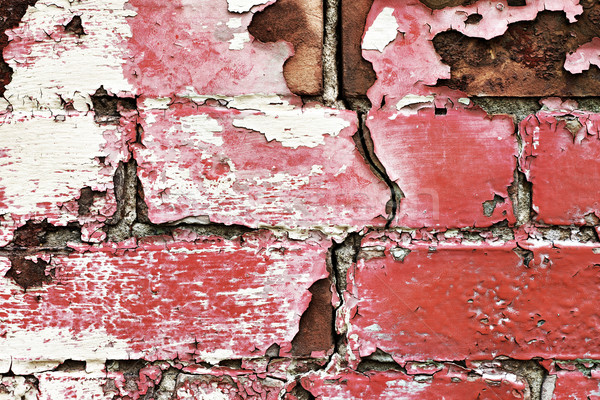 Peeling old painted brick wall Stock photo © soupstock