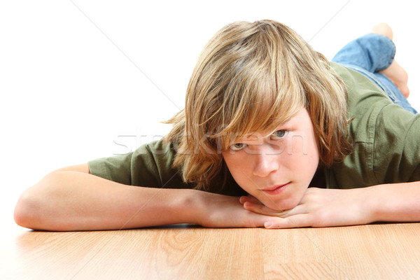 Teen boy laying his head on his hands Stock photo © soupstock