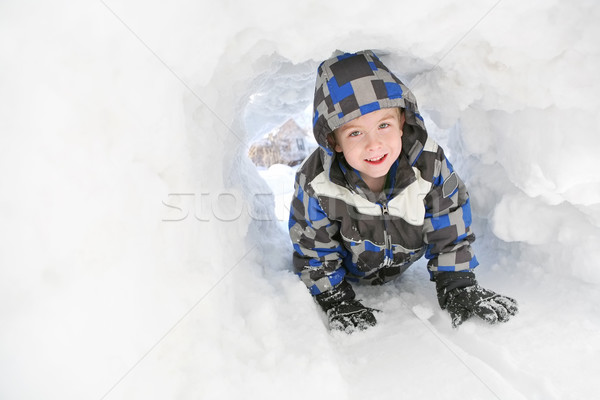 Young boy playing in the snow Stock photo © soupstock