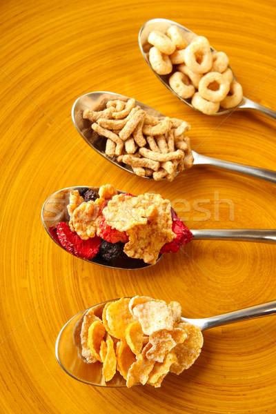 Verschillend ontbijtgranen vier lepels tarwe ontbijt Stockfoto © soupstock