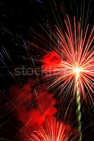 Vuurwerk licht achtergrond nacht donkere Stockfoto © soupstock