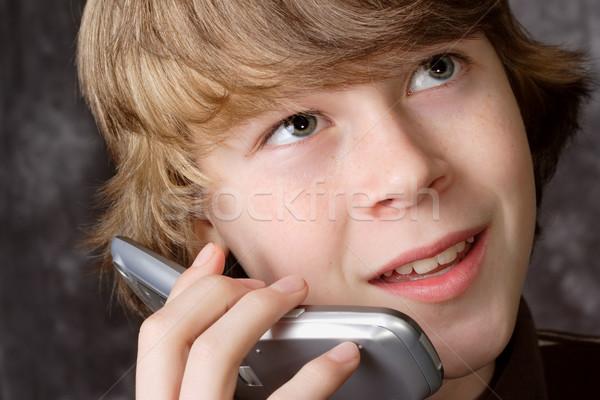 Teen praten mobiele telefoon jongen telefoon gelukkig Stockfoto © soupstock