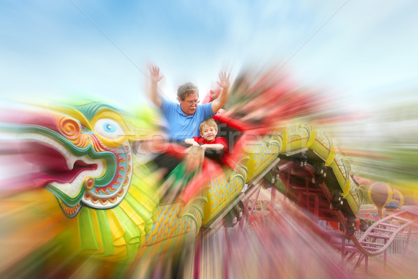 Riding the rollercoaster at the fair Stock photo © soupstock