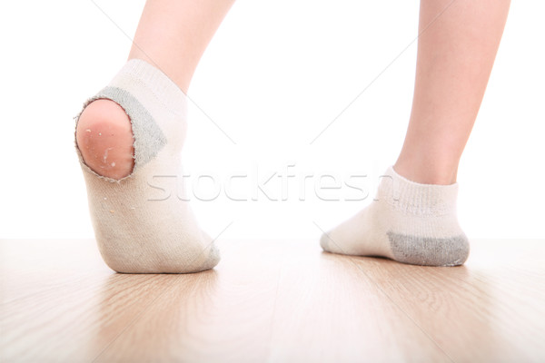 Boy wearing dirty socks with holes in them Stock photo © soupstock