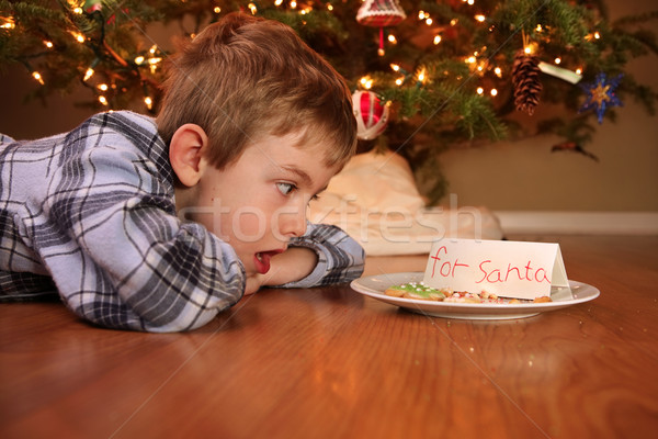 Stock photo: Boy wakes up to find someone ate the cookies