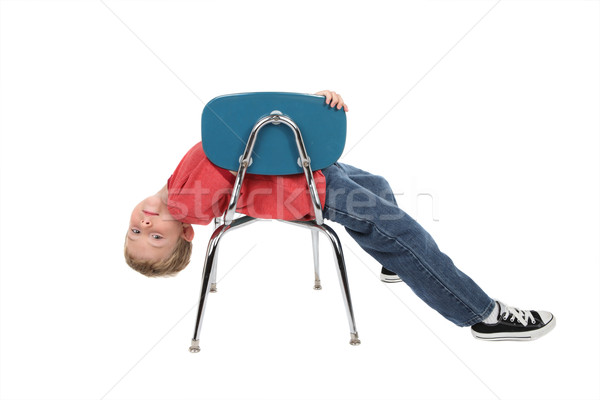 Bored child laying on chair Stock photo © soupstock