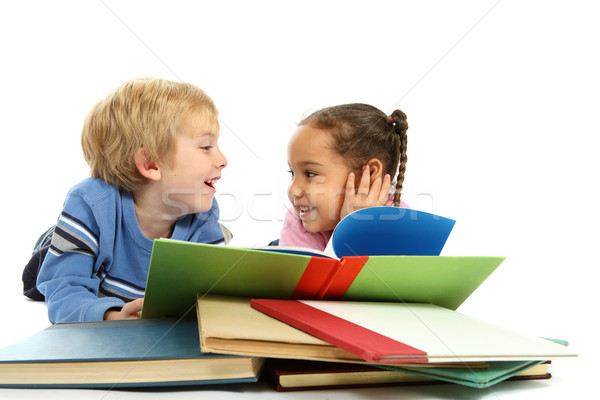 Kids laying down and reading a book Stock photo © soupstock
