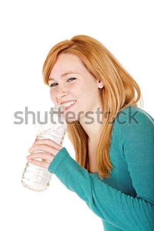 Fiatal nő iszik vizes flakon fiatal nők palackozott víz lány Stock fotó © soupstock