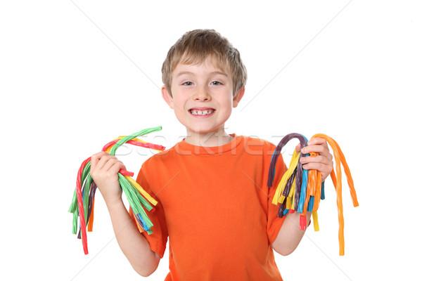 Jongen kleurrijk snoep handen Stockfoto © soupstock