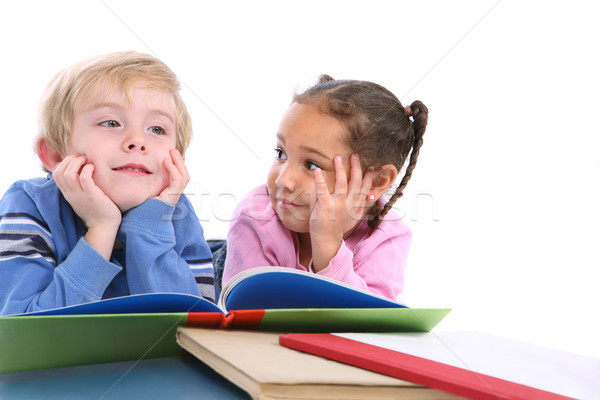 Kids laying down and reading books Stock photo © soupstock
