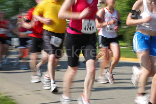 Stock photo: Marathon (in camera motion blur) runners numbers have been chang