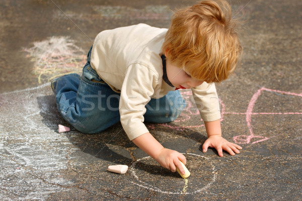 Boy drawing outside with chalk Stock photo © soupstock