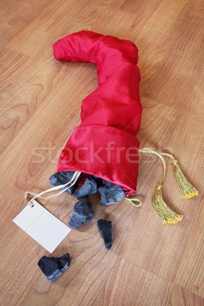 Christmas stocking full of coal Stock photo © soupstock