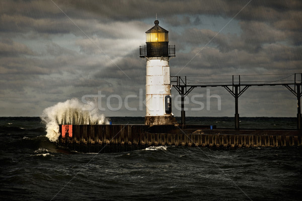 Lighthouse and stormy sea Stock photo © soupstock