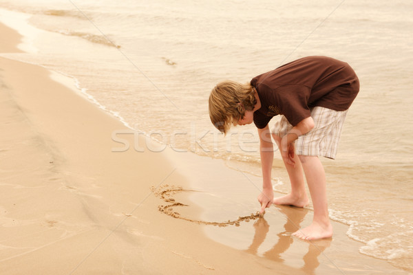 Iscritto sabbia disegno spiaggia acqua Foto d'archivio © soupstock