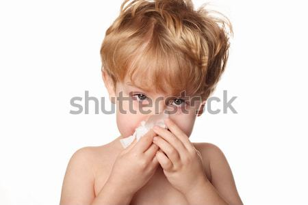 sick child wiping his nose Stock photo © soupstock