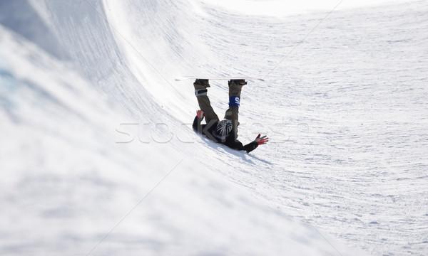 Concorrenza snowboarder indietro metà pipe neve Foto d'archivio © soupstock