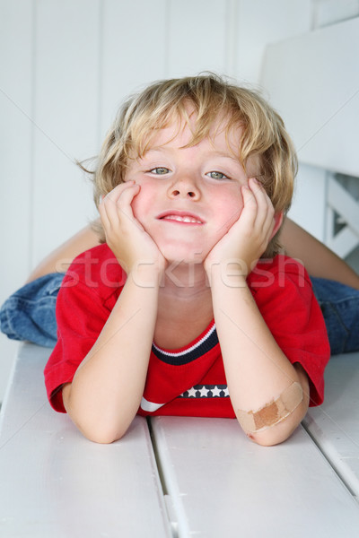 Smiling Boy with a bandaged elbow Stock photo © soupstock