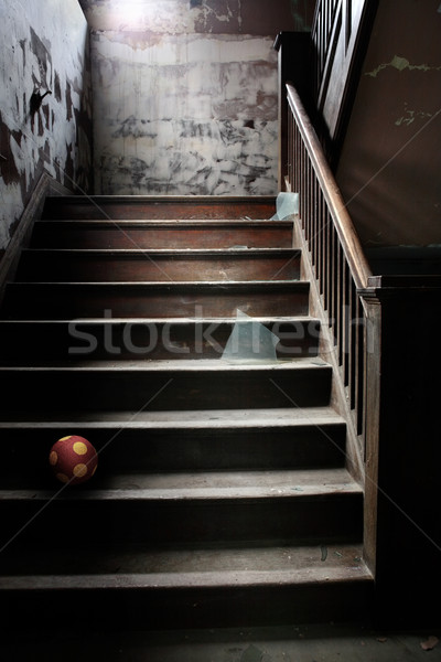 Old abandoned stairs with broken glass and a ball Stock photo © soupstock
