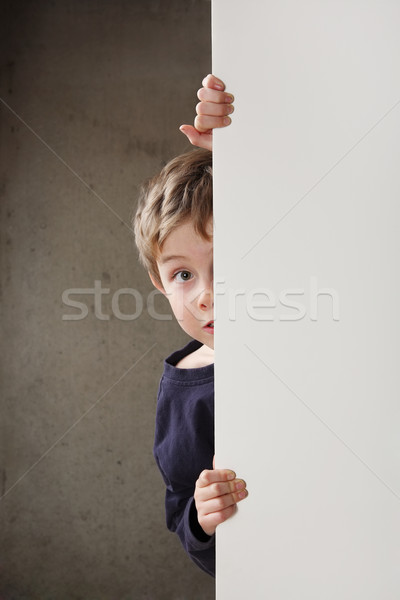 Boy peeking around a wall Stock photo © soupstock