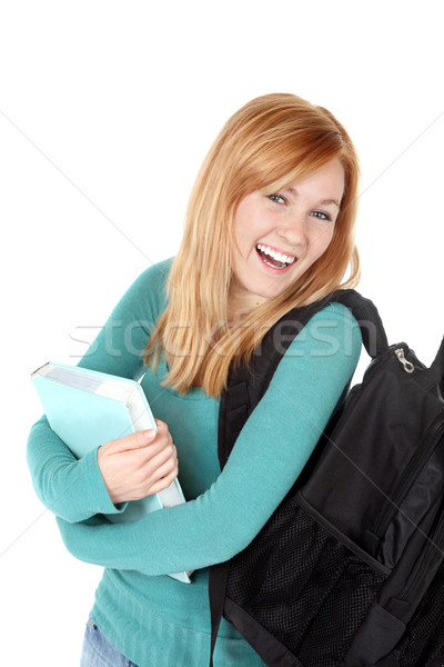 Happy student holding a book Stock photo © soupstock