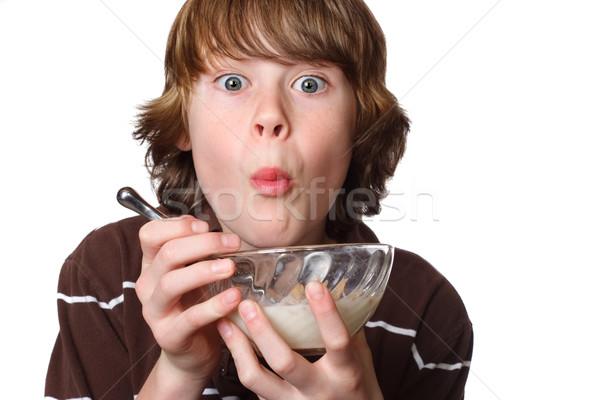 Teen ragazzo mangiare ciotola cereali Foto d'archivio © soupstock