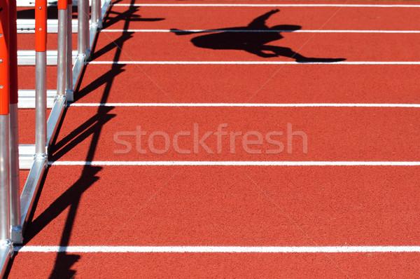 Schaduw persoon springen horden Rood track Stockfoto © soupstock