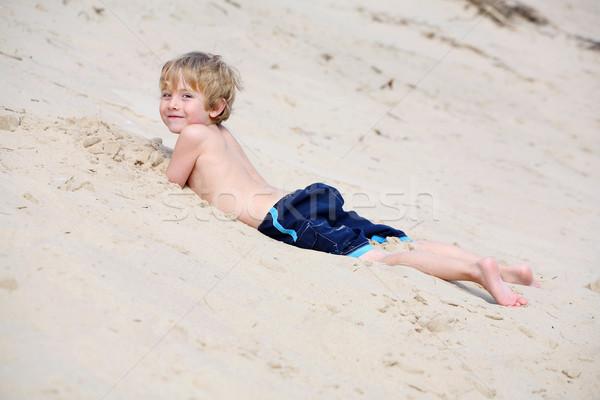 Ragazzo sabbia spiaggia Foto d'archivio © soupstock