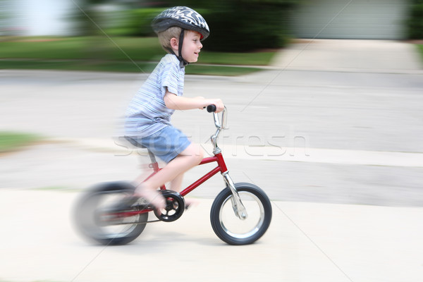 Young boy riding a bike (motion blur) Stock photo © soupstock