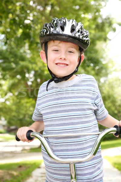 Young boy riding a bike Stock photo © soupstock