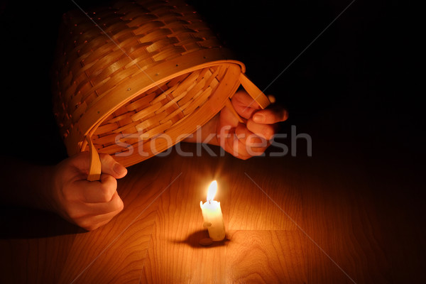 Shining Light (Biblical concept-Hiding your light under a bushel Stock photo © soupstock