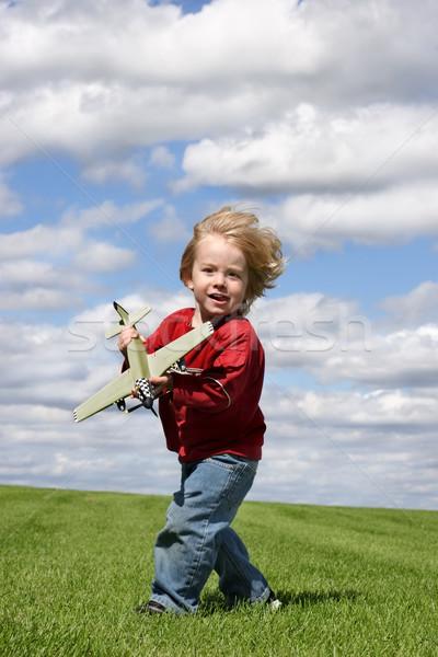 Wind speelgoed vliegtuig groen gras blauwe hemel Stockfoto © soupstock