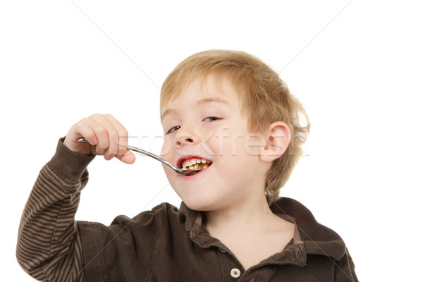 Young  boy eating a spoonful of cereal Stock photo © soupstock