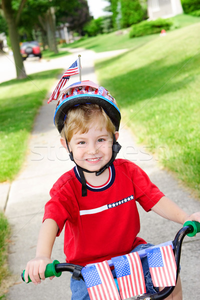 Boy on a bike on the 4th of July Stock photo © soupstock