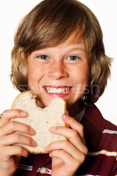 Mangiare sandwich adolescente burro di arachidi faccia Foto d'archivio © soupstock