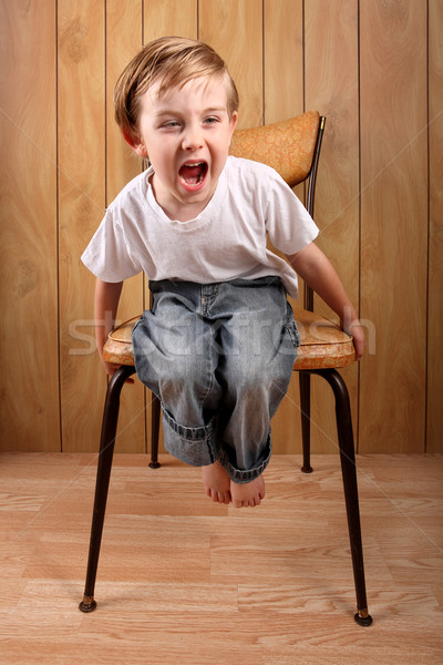 Boy throwing a tantrum while on a time out Stock photo © soupstock