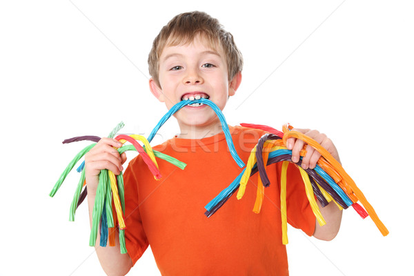 Boy holding colorful licorice candy Stock photo © soupstock