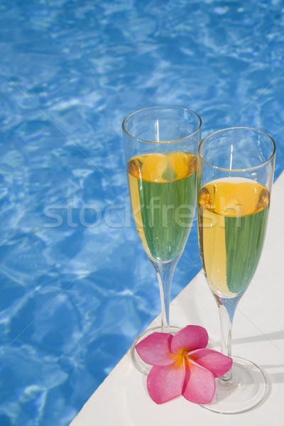 Champagne deux verres bleu piscine rose Photo stock © spanishalex