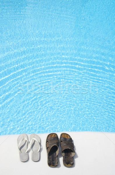 Chaussures piscine deux lumineuses piscine eau Photo stock © spanishalex
