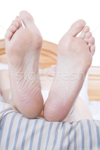 フィート ベッド 縞模様の 女性 ストックフォト © spanishalex