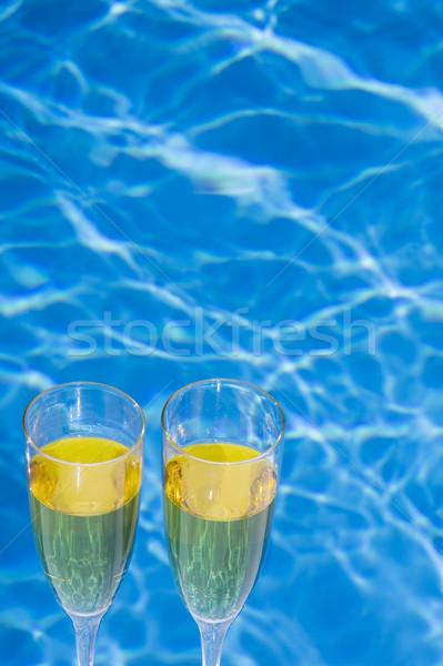 Champán pecado gafas piscina tropicales piscina Foto stock © spanishalex