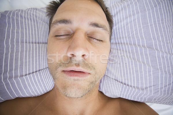 человека спящий голову полосатый подушкой Сток-фото © spanishalex