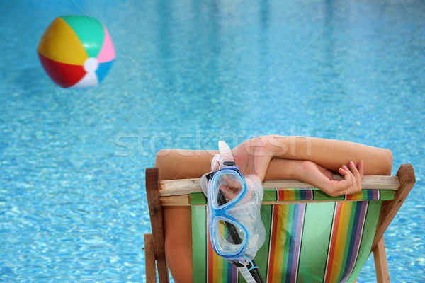 Femme piscine chaise longue bleu Photo stock © spanishalex