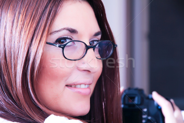 Stock photo: Woman reviewing Photos